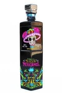Front view of a black premium Anejos tequila bottle with a Dia De Los Muertos skull on the front.